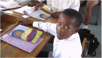 learner with a COOL TO BE ME workbook